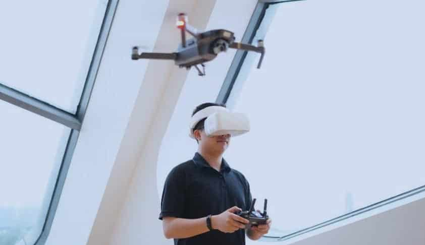 A drone pilot using DJI Goggles in pair with an RC controller.